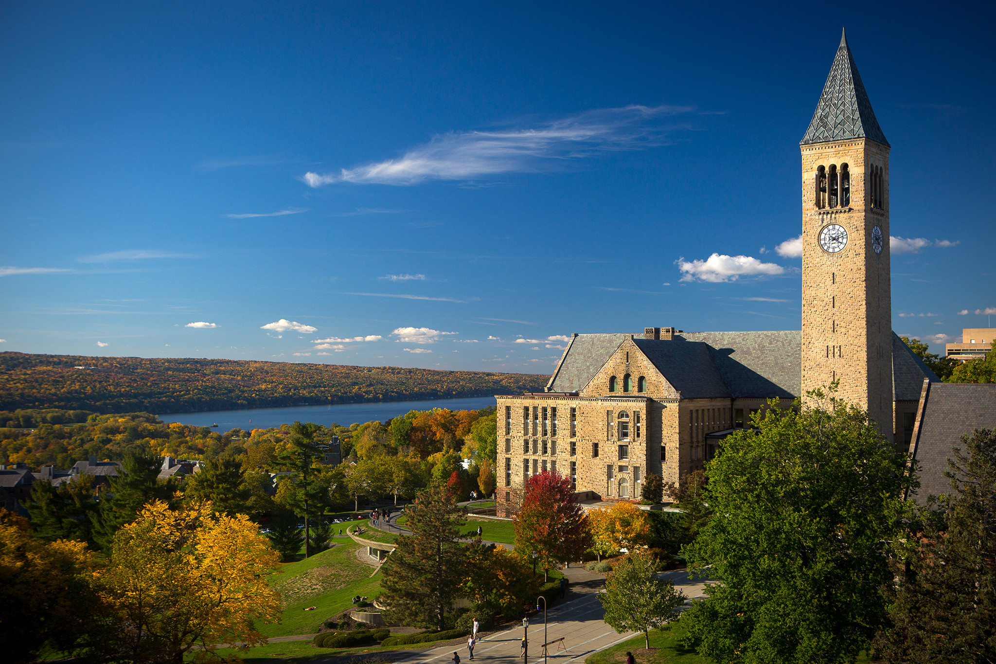 McGraw Tower, Uris Library, Ho Plaza, and Cayuga Lake in fall.