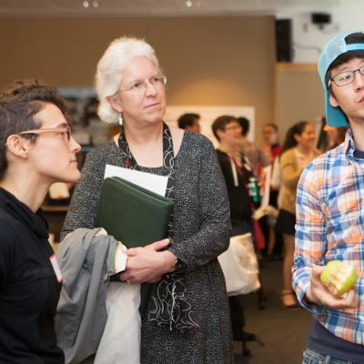 Graduate School Dean Barbara Knuth chats with students at the 2015 Center for the Integration of Research, Teaching, and Learning (CIRTL) Classroom Research and Teaching Symposium.