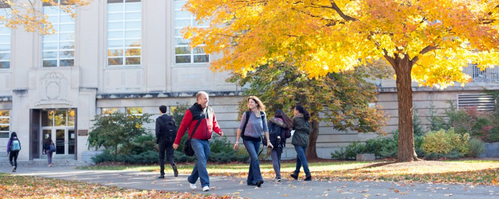 Students walking by Mann Library