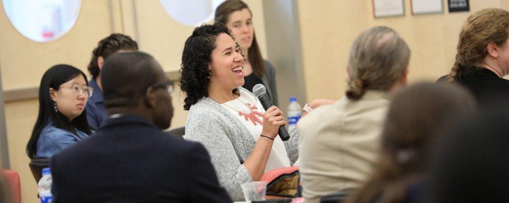 Postdoc Ana Maria Porras asks a question at the Future Professors Institute 2018