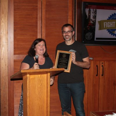 Oliver Bracko receives an award for achievements in teaching and mentoring