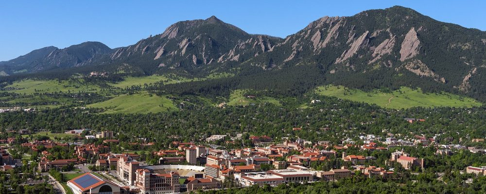 University of Colorado Boulder in summer with mountains behind