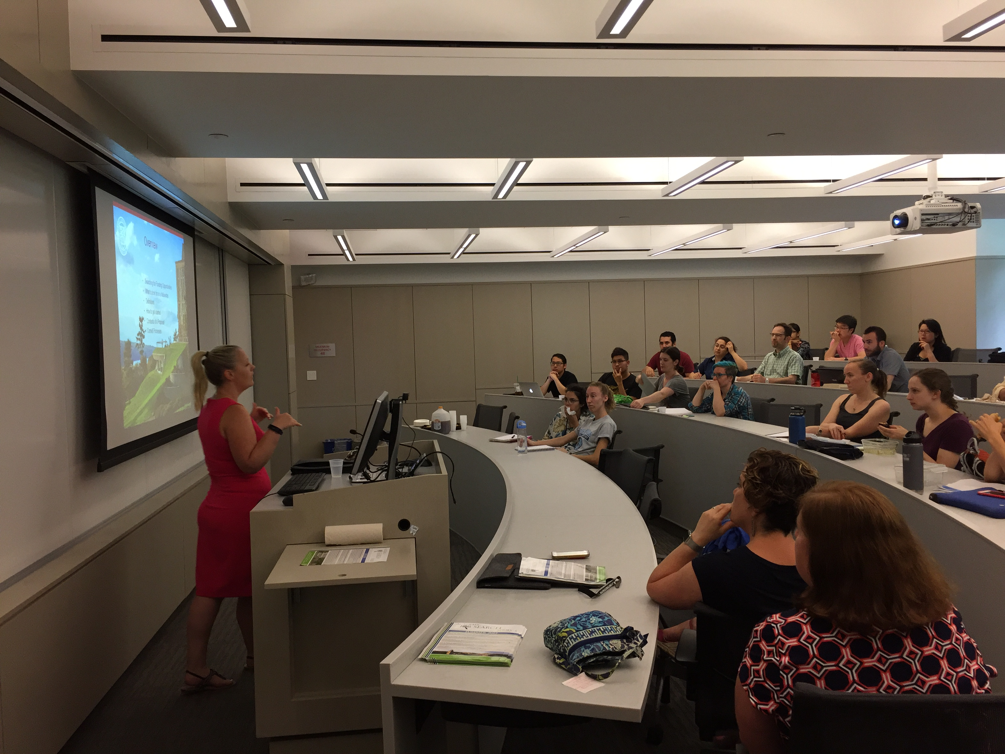 Kim Holloway, Office of Sponsored Programs, presents slides to a room of graduate students and postdocs