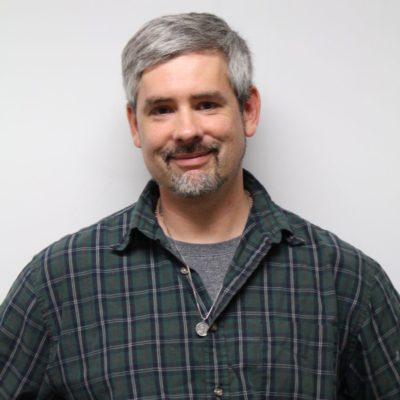 Headshot of graduate student John Wyatt Greenlee