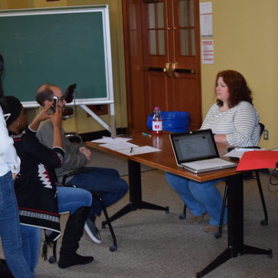 Careers Beyond Academia participants practice being interviewed about their research in a communication workshop.