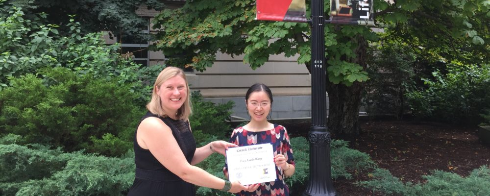Lucy Xiaolu Wang displays her CIRTL Scholar certificate