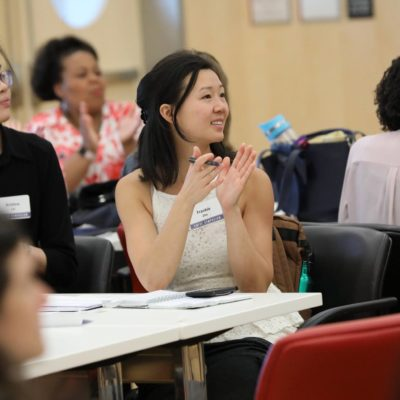 Frankie Zhu (Ph.D., 2019) applauds a session at the 2018 EWISE Symposium