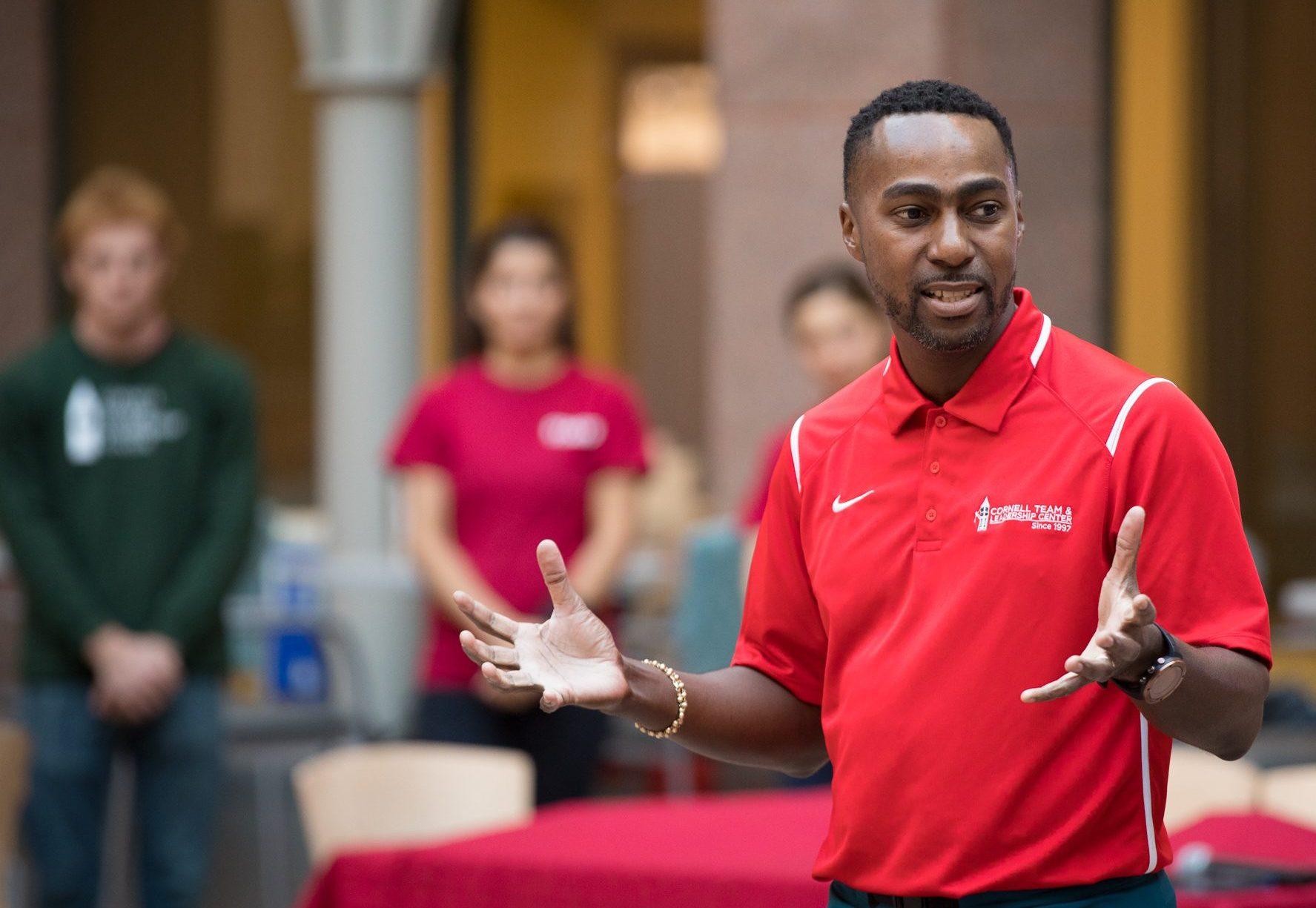 Marcus Brooks presenting in an atrium