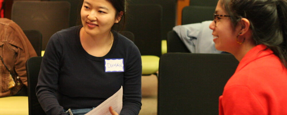 Duhan Zhang and Claire Meaders engage in discussion